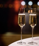 Tall glass champagne flutes with bride and groom names engraved in glass