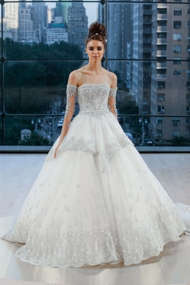 Encrusted strapless ball gown with detachable sleeves, wide hem border and removable mini overskirt.