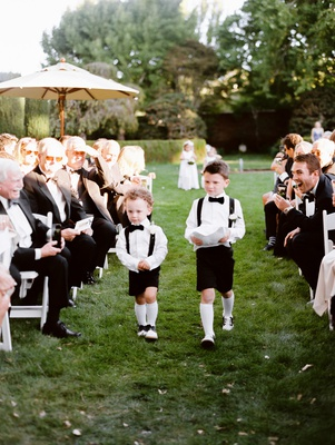 two ring bearers in shorts and suspenders with white knee socks