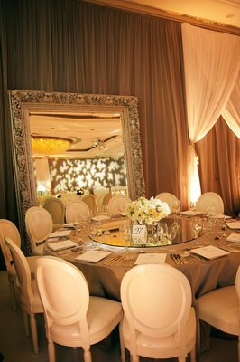Intricate mirror frame and tabletop centerpiece
