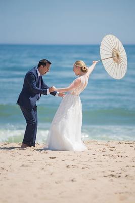wedding portrait bride groom reaction first look parasol beach montauk east coast new york