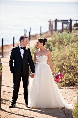 Groom in tuxedo and bride in Monique Lhuillier wedding dress at Terranea Resort