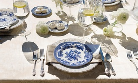 Sun-drenched table with blue and white china