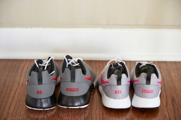 Groom grey and black custom Nike shoes and bride grey and white custom kicks