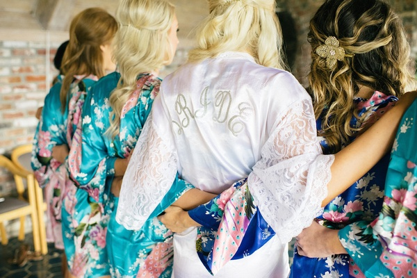 Bride in white robe and bridesmaids in kimonos