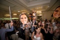 wedding guests dance on the dance floor with large cardboard cutouts of bride groom and ring bearer
