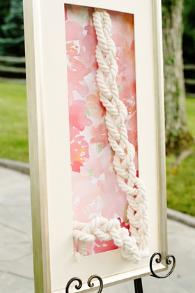 wedding ceremony white frame with flower print backdrop strong cord unity braid ritual