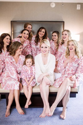 bride white robe bridesmaids pink robes patterns getting ready beauty dallas wedding flower girl