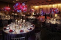 Mirror wedding tables with purple and red centerpieces