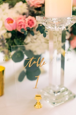 wedding reception table number on gold stand acrylic lucite sheet with gold calligraphy table 1