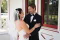Bride in strapless wedding dress embroidered veil headpiece teardrop earring groom tuxedo first look