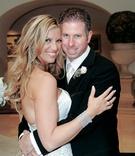 Groom embraces bride in wedding photo