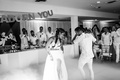 black and white photo of native american bride and irish groom first dance with fog