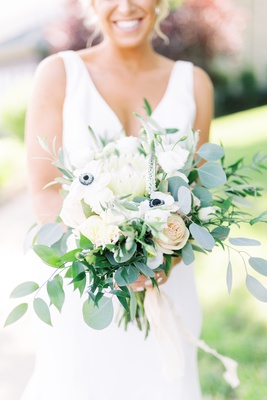 bridal bouquet with white roses, anemone, eucalyptus leaves