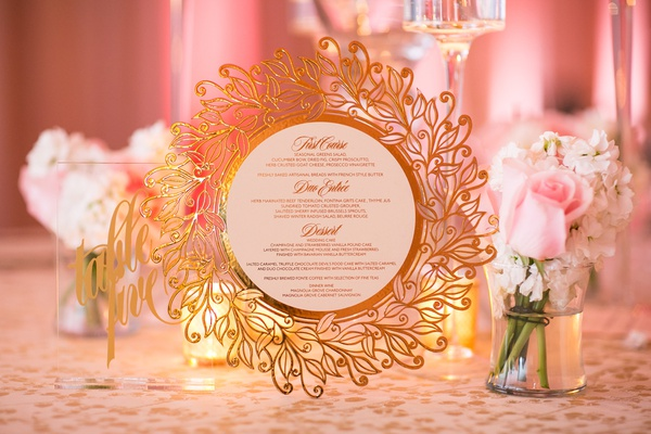 elaborate wedding menu with gold laser-cut border in leaf pattern
