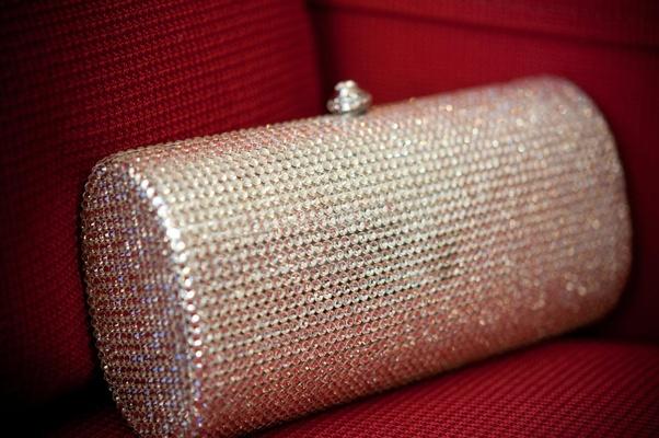 Rhinestone studded wedding purse on red couch