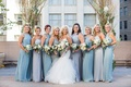 bride in blush by hayley paige, bridesmaids in dusty blue and silver