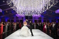 Purple lighting glass tent wedding reception with flower ceiling treatment Vera wang wedding dress