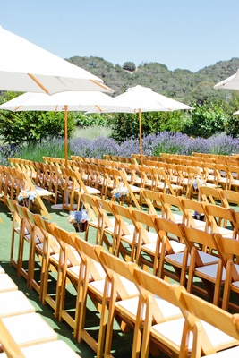 Alfresco wedding chair rows and umbrellas