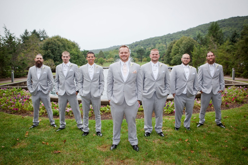 ashley alexiss wedding groomsmen in light grey suits white ties and pink tie for groom