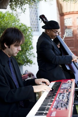 Men playing standing bass and keyboard
