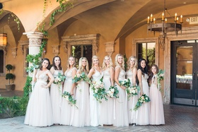 Bride with bridesmaids ivory and blush mismatched dresses junior bridesmaid greenery bouquets villa