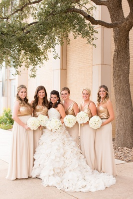 Bride in ruffle Kenneth Pool wedding dress with custom bridesmaid dresses