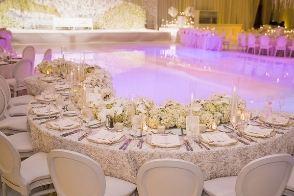 winding table around reflective dance floor indian hindu wedding purple lighting florals
