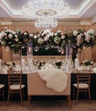 Suzanna Villarreal and Alex Wood LA Dodgers wedding reception fall decor tall centerpiece fur