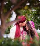Bride in lehenga and groom in sherwani for vibrant Hindu wedding ceremony