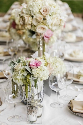 Reception centerpieces filled with pale flowers