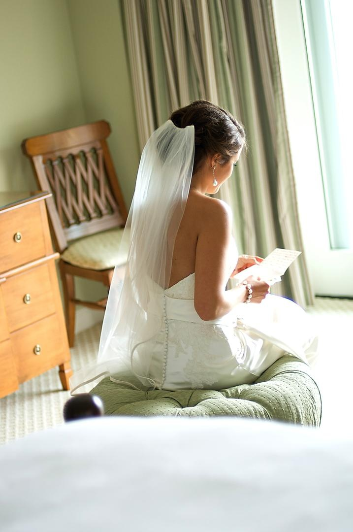 Bride reads wedding letter from groom