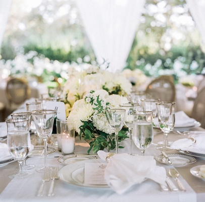 White table runner with green and white flower centerpieces