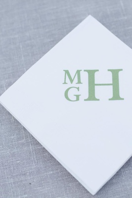 Square napkins printed with couple's monogram
