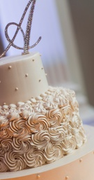 Ivory and Blush Buttercream Wedding Cake with Monogram Topper
