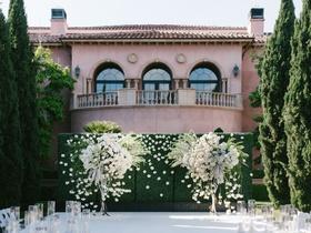 cheryl burke matthew lawrence wedding ceremony grand del mar mindy weiss white flowers green hedge