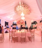 Marquee wedding with drapery and romantic flowers