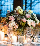 wedding reception centerpiece with blush and ivory flowers, lilacs, and greenery