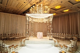 white and gold detailed chuppah at jewish and christian wedding ceremony