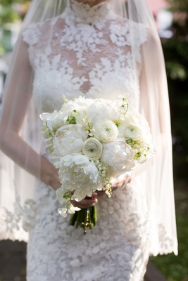 bridal bouquet white peony ranunculus flowers lily of the valley lace wedding dress
