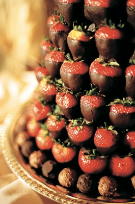 Tower of chocolate strawberry fruits and truffle rim