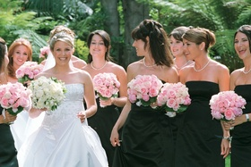 Bridal party in strapless white and black gowns
