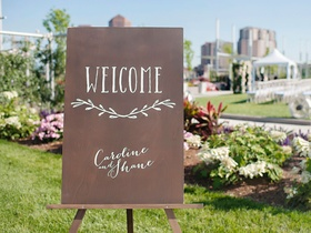 Cincinnati wedding venue outdoor ceremony with welcome sign wood calligraphy on easel rustic wedding