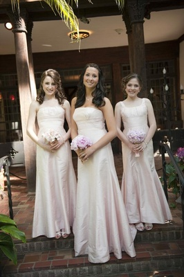 Bridesmaids in long pale pink dresses