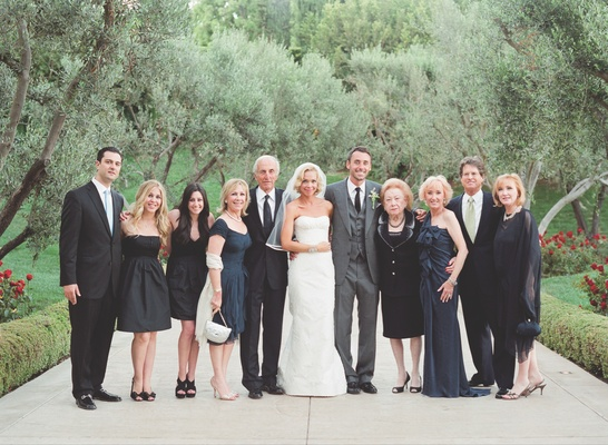 Simone Harouche in a strapless Carolina Herrera gown, groom in a grey Tom Ford suit with loved ones