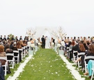Alfresco wedding with petal-lined aisle
