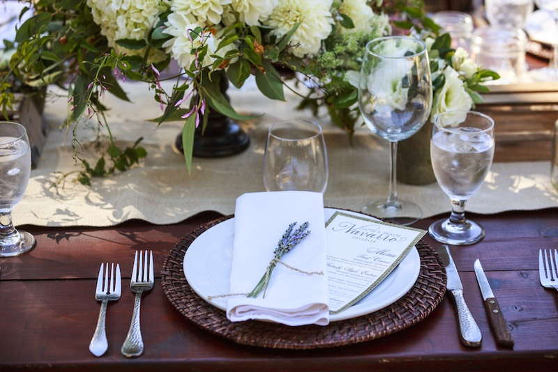 Ranch wedding wood reception table with rattan charger lavender bundle on white napkin. Photographed by Mischa Photography. Place settings ... & Reception Décor Photos - Elegant Rustic Place Setting - Inside Weddings