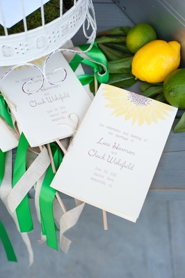 Yellow sunflower wedding program with green ribbons
