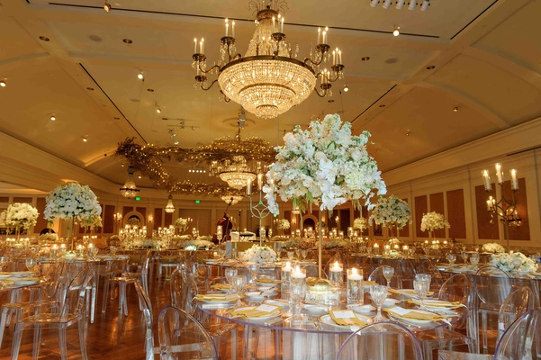Clear Ghost chairs with acrylic tables and white centerpieces