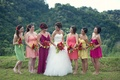 Mismatched short bridesmaid dresses in tropical colors